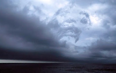 storm clouds over dark ocean