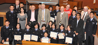 The Second Cohort from Zhejiang Police College pose with SHSU faculty members during certificate ceremony