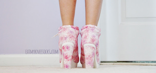 Back details of the pink floral-print white lace-up high-heel platform booties from AMIClubwear.