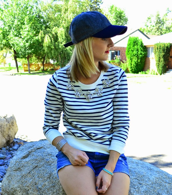 baseball hat, jeweled sweatshirt, shorts, boots, fashion blogger