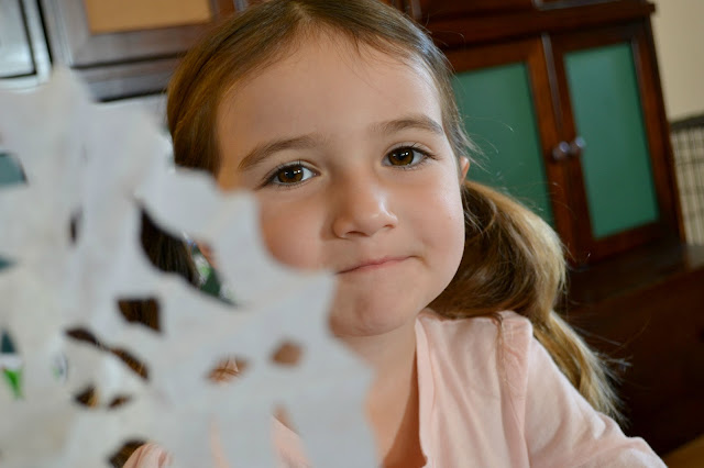 snowflakes for Sandy Hook, making coffee filter snowflakes
