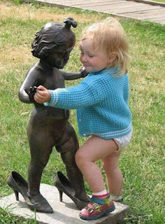 Cute Girl Dancing With Statue
