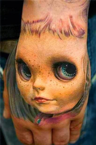 Ιmpressive 3D face doll tattoo.