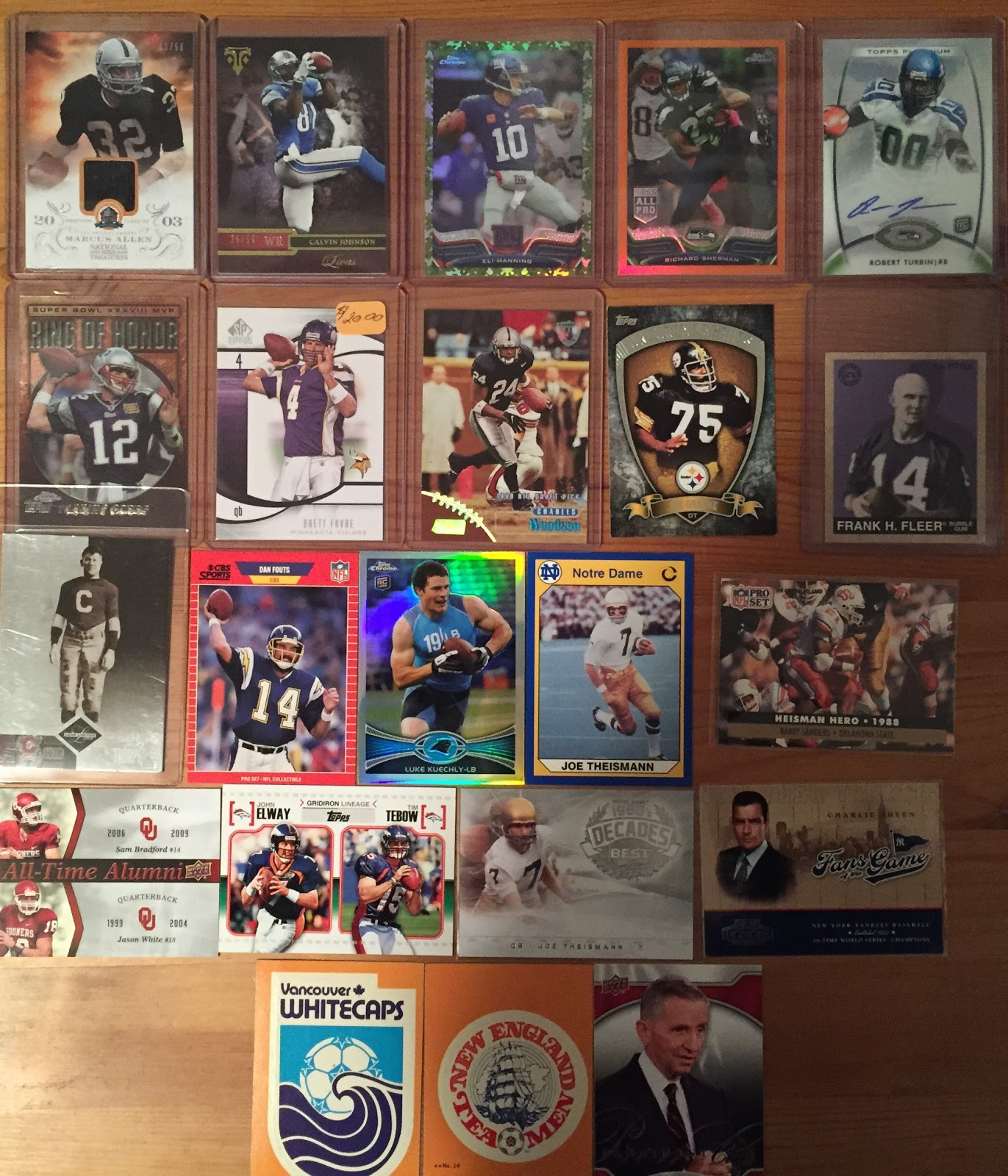 what i have been buying lately trip to the big sports card 2013 panini national treasures hof 50th anniversary materials marcus allen 27 50 2014 topps triple threads ruby calvin johnson 54 50
