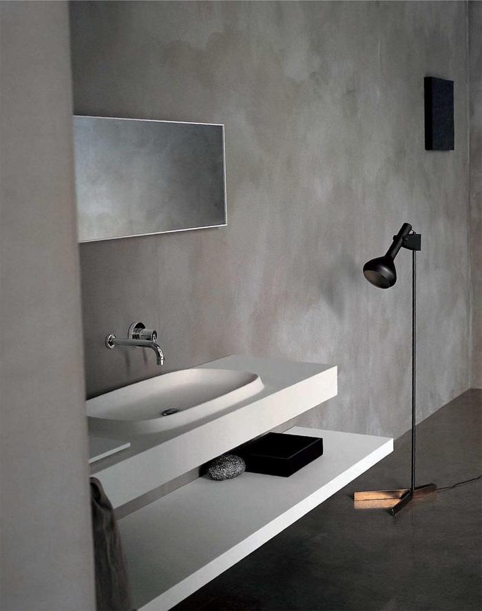 revestimiento  baños de diseño microcemento  y lavabo moderno blanco de agape