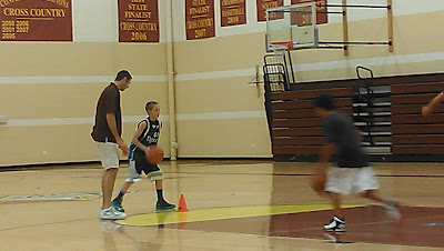 Northridge basketball teaching youngsters how to play the for How much to build a basketball gym