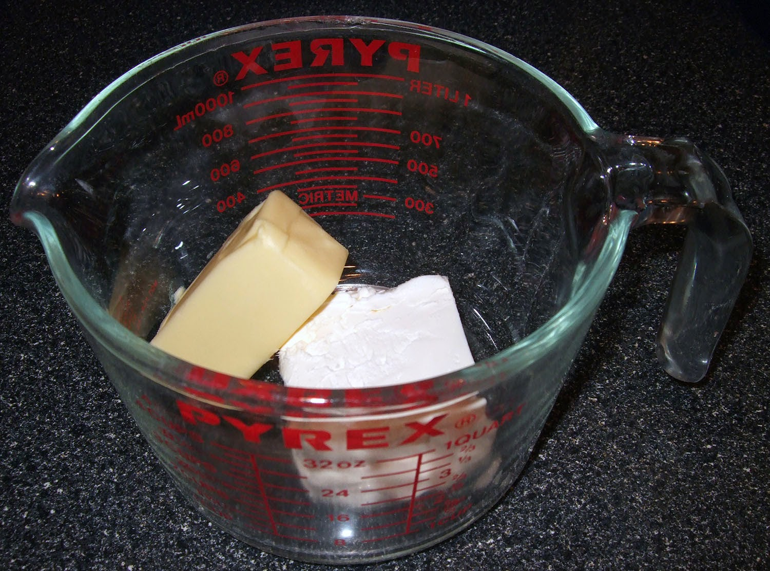 Cream cheese and butter in measuring cup.