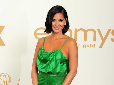 Olivia Munn in green emerald silk gown at 2011 Emmy Awards