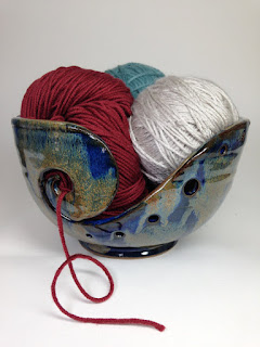 "This ceramic yarn bowl is thrown in the traditional Korean style. The inner and outer glazes are a combination of French Blue and Red-Brown. The Red-Brown creates a beautiful bronze-gold speckled effect on the deep blue background. This yarn bowl can accommodate lace to DK weight yarns. This bowl makes the perfect gift for anyone who knits or crotchets.  The jumbo is about 5.5"" tall and 10"" wide. The large is about 4.5"" tall and 8"" wide. The medium is about 4.25"" tall and 7"" wide. The small is about 4"" tall and 6"" wide.  **The bowls will take about 3 to 4 weeks to complete. Once fired, I use priority mail, so it will only take 2-3 days to ship.**  I can ship international, so please feel free to contact me about shipping prices.  I can make a customized knitting bowls, so feel free to message me if you want a smaller or larger bowl like this one."