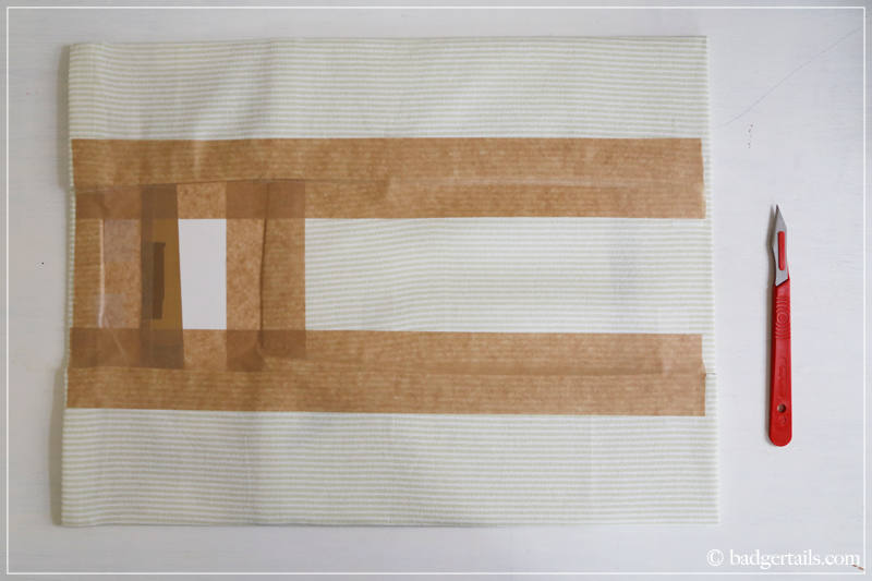 How to Frame a Tea Towel - tape up all four sides
