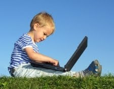 toddler holding a computer