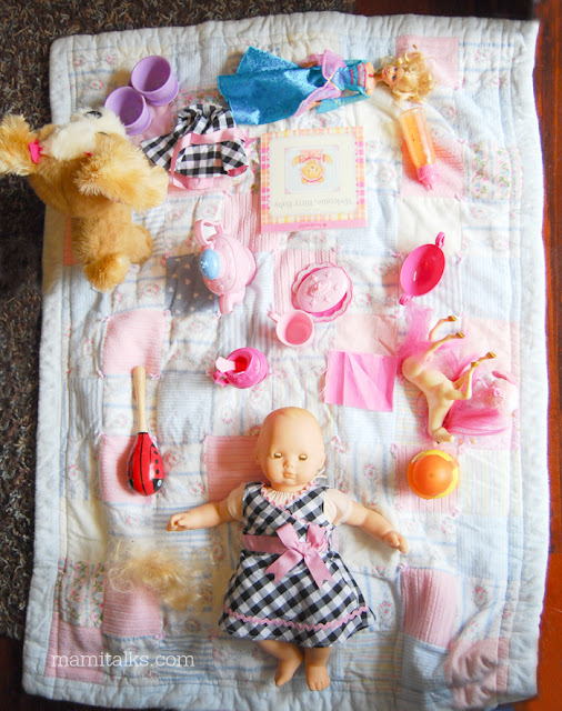 blanket with organized girl toys
