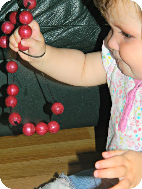 Baby girl playing with the Gumigem Bubba Beads Pipsqueak