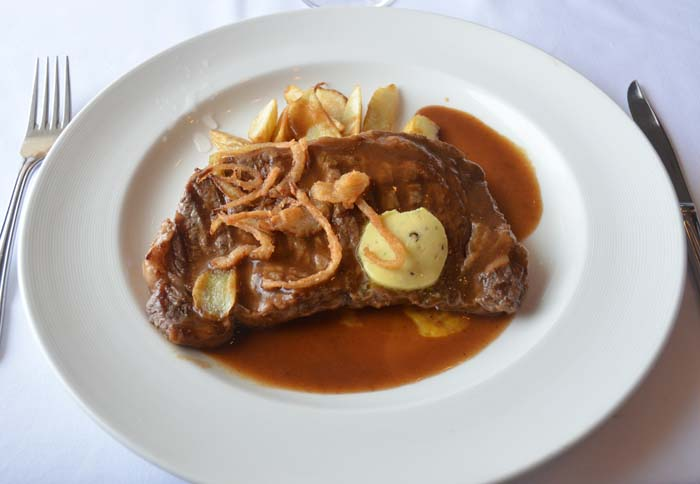 course - grilled rib eye steak, garlic and black pepper butter, fried ...