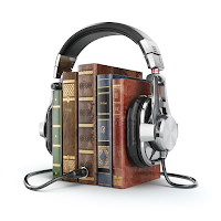 image of a stack of books with and a set of headphones patched into them.