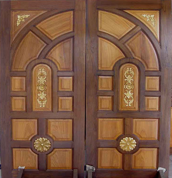 Double front door designs wood kerala special gallery for Door pattern design