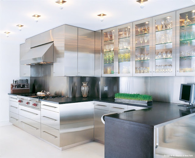 kitchen with stainless steel cabinets and black counter tops