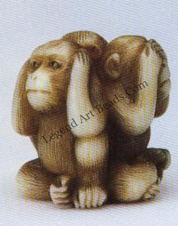 """A stained ivory version of Hear no evil, speak no evil, see no evil.""""Length, 1.4 cm."""