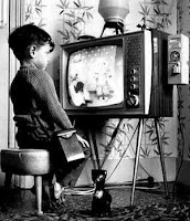 black and white image of child watching television 
