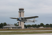 Trimotor Takes Off In Front of the Airport Tower