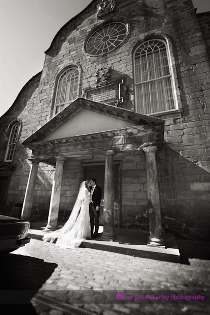 Bride and groom have a kiss outside the church