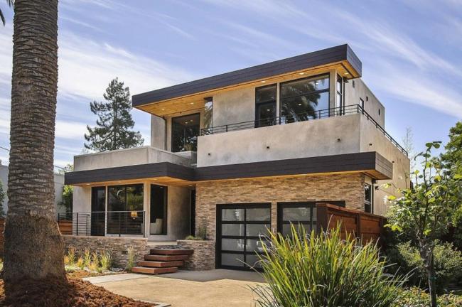 Casa moderna con fachada de piedra y mucha luz natural Casas de piedra modernas