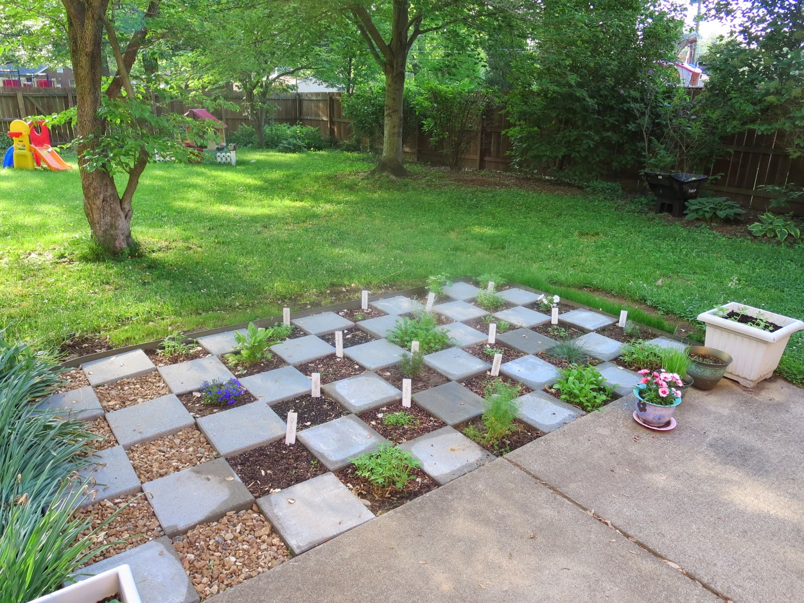 Checkerboard herb garden back home again checkerboard for Checkerboard garden designs