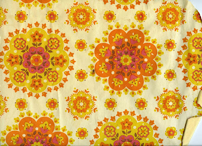 wallpaper 60s 70s yellow orange floral circular pattern design on wall of house built in about 1970 fading and tattered rotated 5 DHD