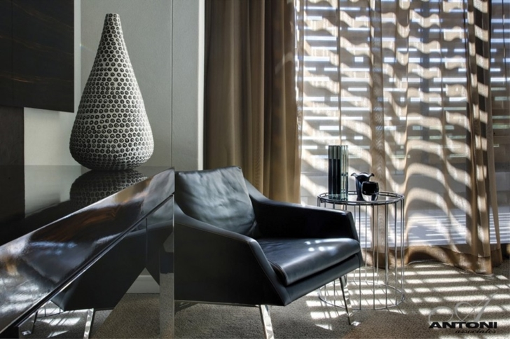 Black leather chair in Head Road 1843 by Antoni Associates