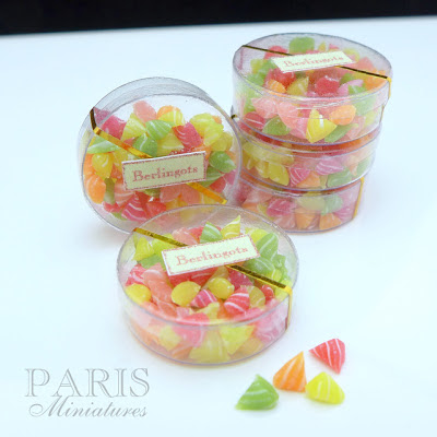 Five boxes of berlingot candy in miniature