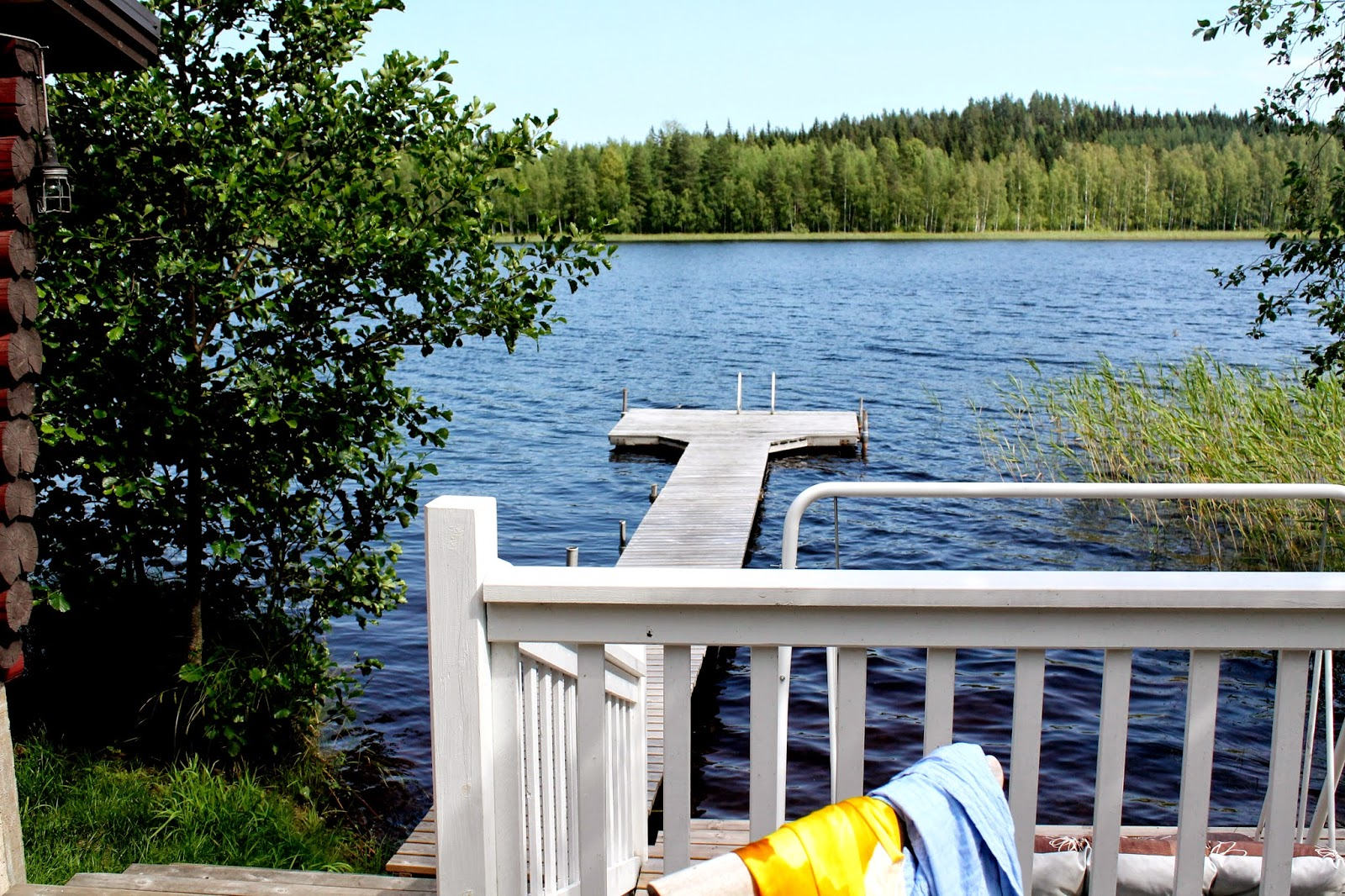 Oh, to jump in that lake! Travel in Finland, swimming in lake Saimaa, cottage view from terrace,