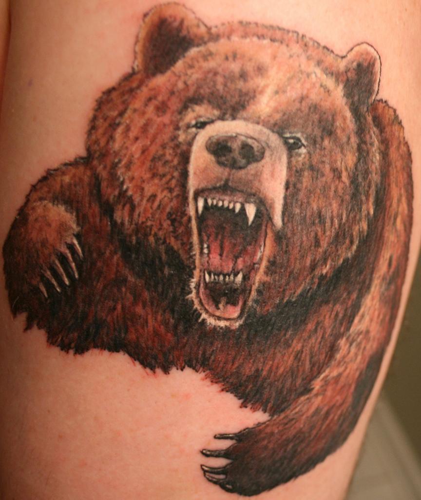 Что означают наколки медведь