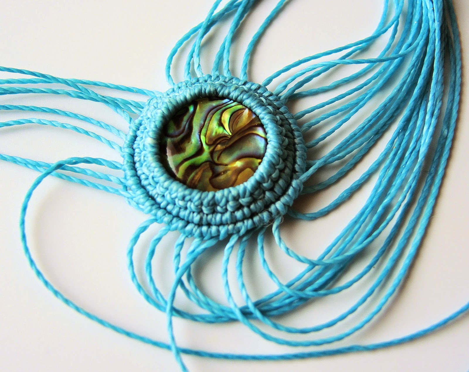 Macrame bezel knotted around a cabochon