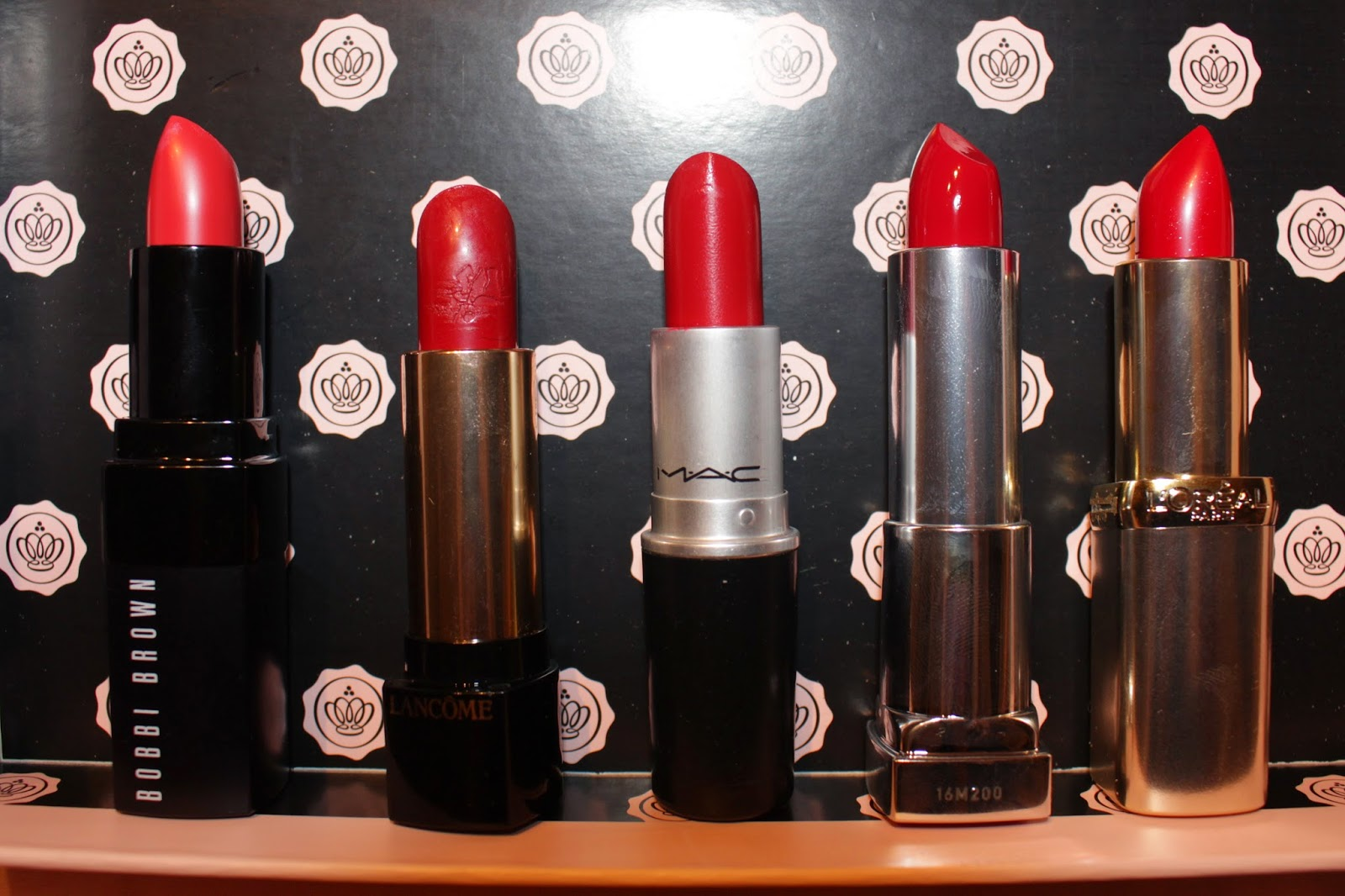 With Flash: L to R: Bobbi Brown Rich Lip Colour in 42 - Watermelon, Lancôme L'Absolu Rouge in 173 - Preciosa, MAC Brave Red Cremesheen, Maybelline Colour Sensational in 547 - Pleasure Me Red, L'oreal in 297 - Red Passion