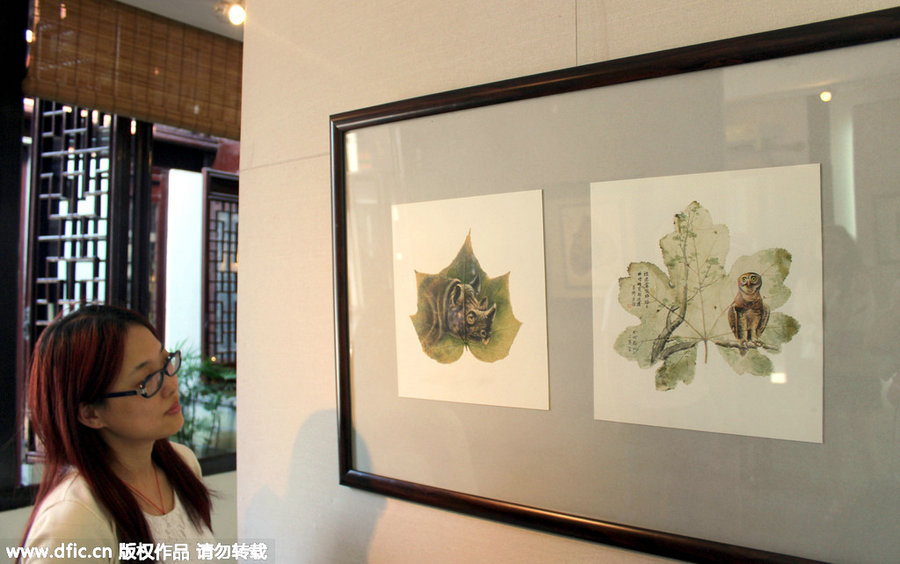 06-Rhino-and-Owl-Pang Yande-Leaf-Painting-Folk-Art-and-Environmental-Protection-www-designstack-co