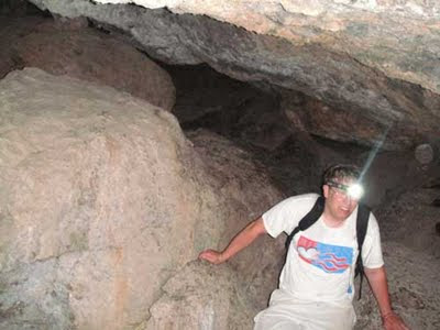 Me in cave with headlamp on