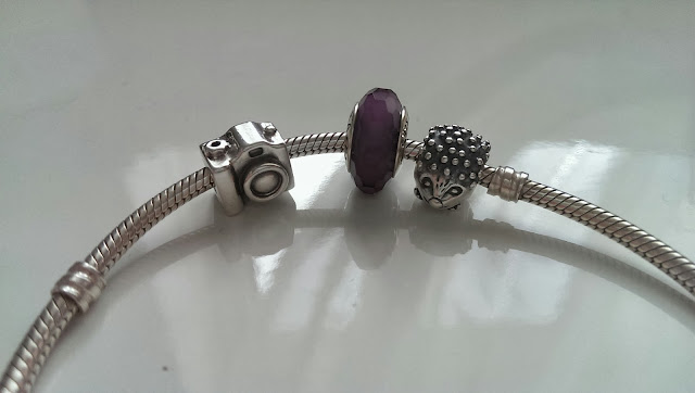 A close up of my Pandora charms