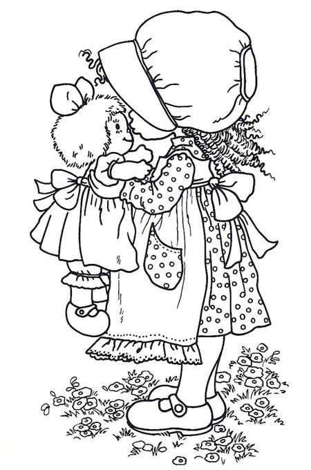صورة بنت تقبل دميتها لتلوين الاطفال