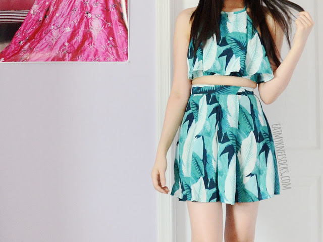 WalkTrendy sells tons of cute, colorful clothes for summer, like this two-piece leaf-print crop top and matching shorts set.