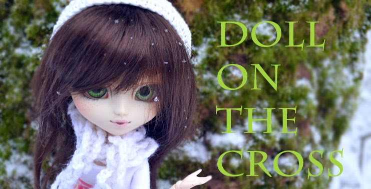 Doll On The Cross
