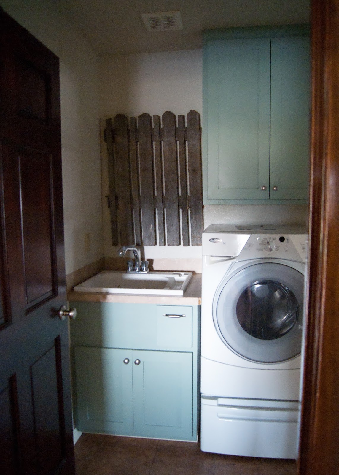 Laundry Room Makeover - After - Green blue cabinets and old fence decor