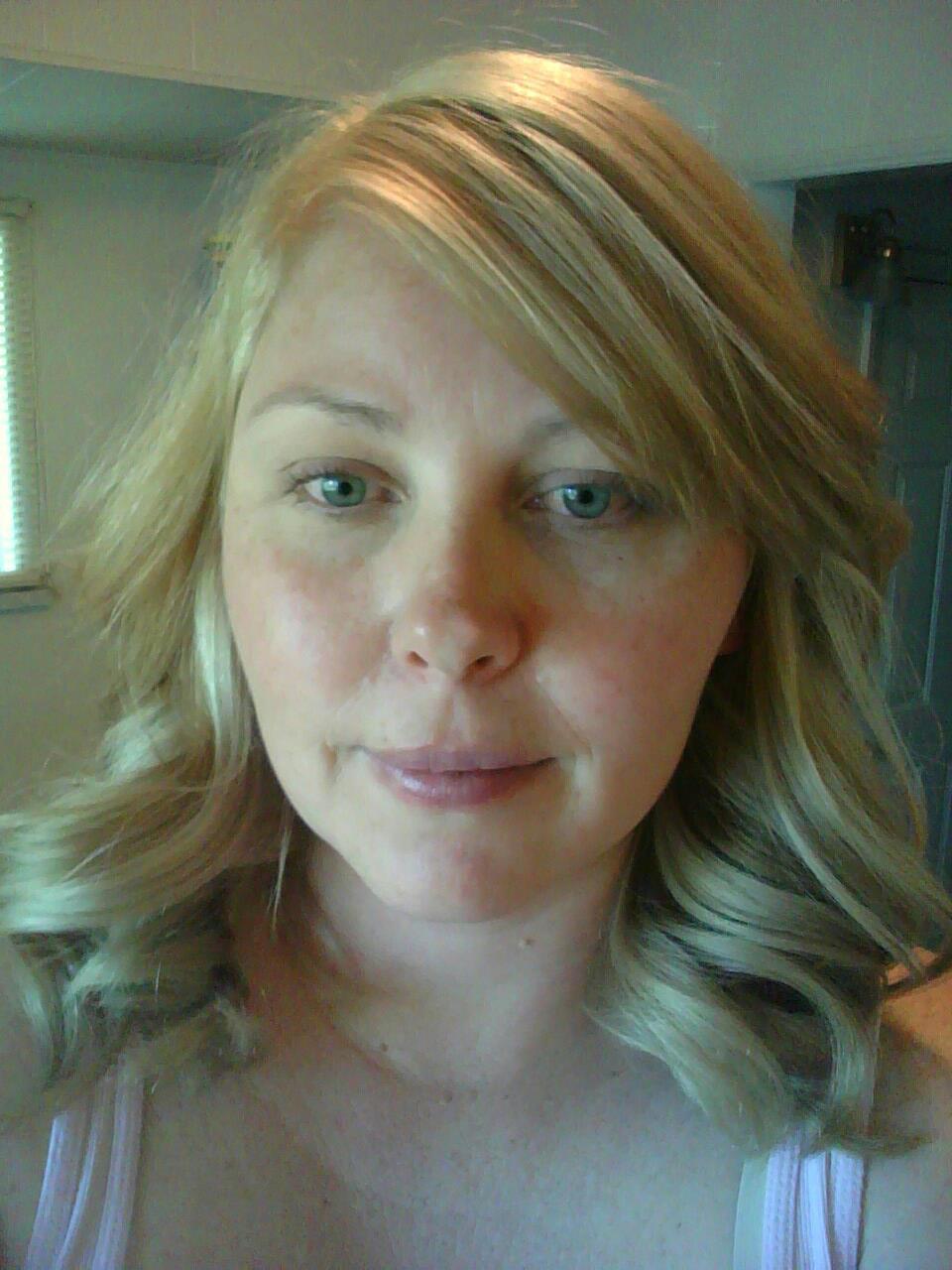 Curled blonde hair
