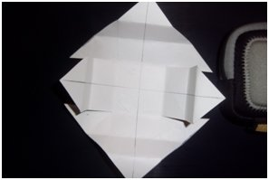 fold and cut paper card to form box