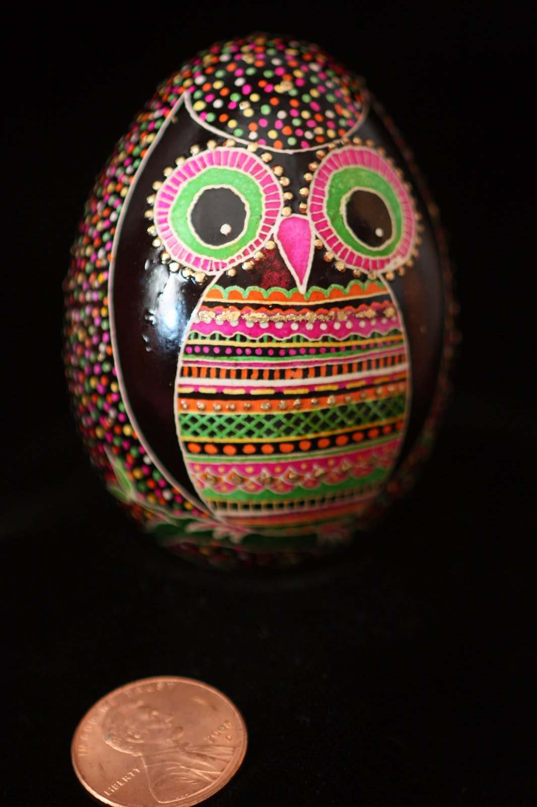 Owl Pysanky with Gilded Dots in Pink, Orange and Green on Black Background