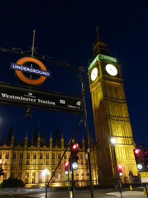 Big Ben lit up at night, Westminster Underground station sign