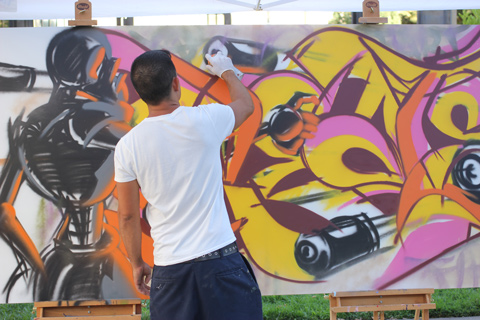 Graffiti Artist Paydirt using Black images with purple, pink and yellow.