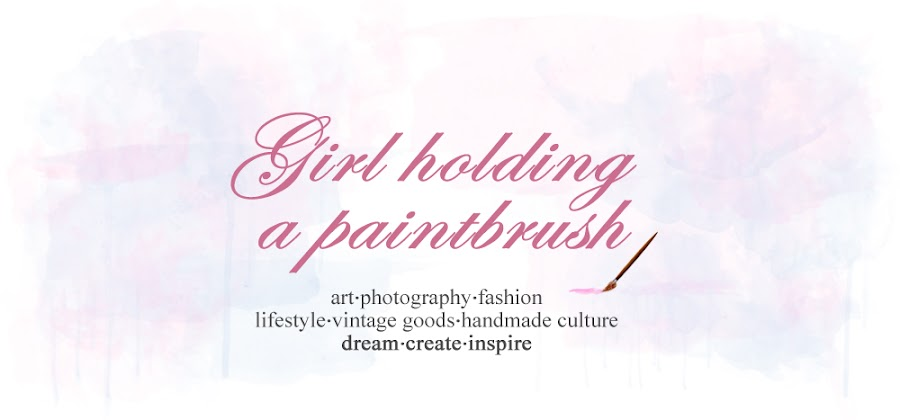 Girl holding a paintbrush