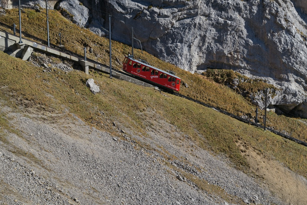 we will go down from the opposite side of the mountain using the pilatus cogwheel railway we will take this nice red train