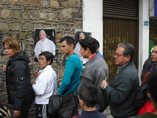 A photo portrait of Pope Francis for sale on the streets of Bogotá during Holy Week