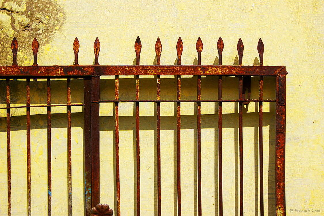 Minimalist photography by prakash ghai rusty entrance gate for Minimalist house gate